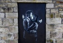 Phone-Lovers-Street-Art-by-Banksy-in-Bristol-England-fb